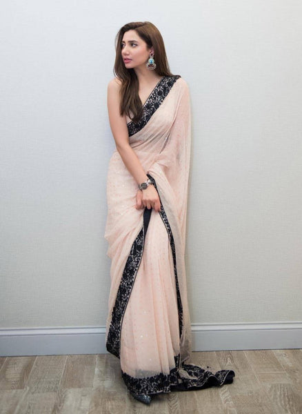 Desirable Peach Colored Georgette Embroidered Designer Saree