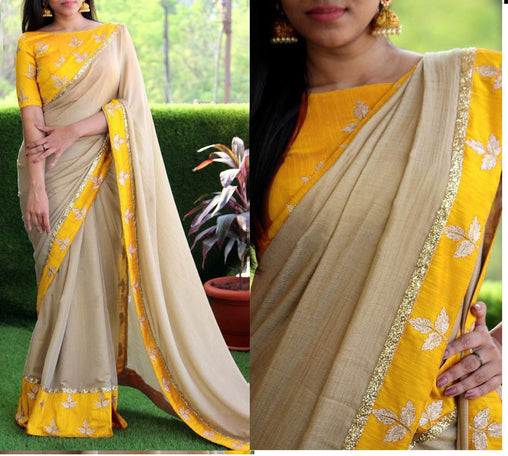 Adorable Cream And Yellow Color Georgette Embroidered Designer Saree