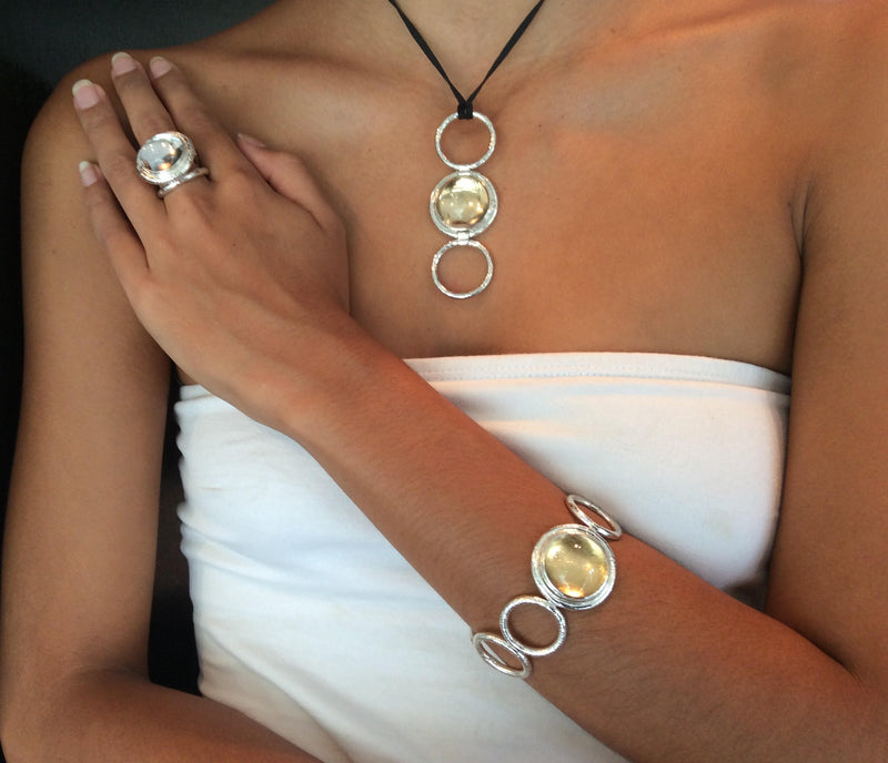 Our model is wearing the Single Cobocon  Rock Crystal braclet, and the Cobocon Rock Crystal Ring that can be worn as a pendent.