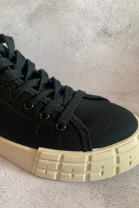 Black canvas high top trainers