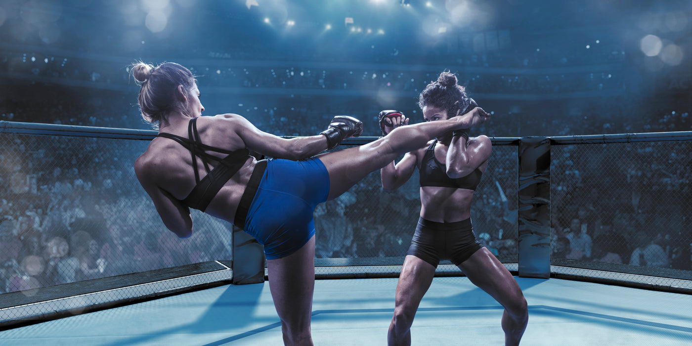 An image of two female professional mixed martial arts fighters fighting in the octagon.
