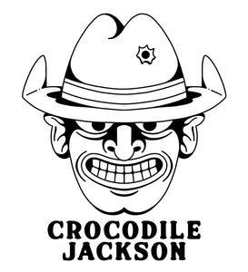 Black and white colored logo for Crocodile Jackson.   Cowboy portrait with a shit eating grin and a bullet hole in his hat.