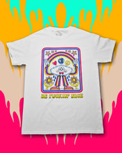 "Load image into Gallery viewer, White t-shirt with the words ""Be Fuckin' Nice"" in yellow retro font at the bottom and a cloud character wearing a blue, pink, and yellow striped pantsuit with pink checkered sneakers. The cloud is grinning with 2 tongues sticking out, casting a rainbow between his raised hands with water drops below the armpits watering the 2 yellow and polka dot flowers below his arms. Heart, globe, and peace sign are between the cloud head and the rainbow, 6 polka-dotted stars are above the rainbow."