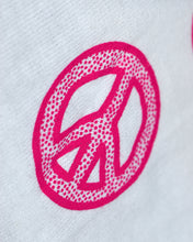 Load image into Gallery viewer, Close-up of one of the designs on the sleeve: of the peace sign. The design is a thick peace sign with bolded edges and dots within these borders. The designs are hot pink.