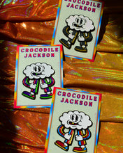 "Load image into Gallery viewer, 3 variations of a peppy cloud character called ""Cloudia"" in the form of an enamel pin.  The striped pantsuit of the glitter pin has grey and yellow stripes with matching colored sneakers.  The second pin has a pink, purple and green striped pantsuit with matching sneakers.  The third pin has blue, red and yellow striped pantsuit with matching sneakers.  The googly eyed cloud head looks as if he's dancing and singing."