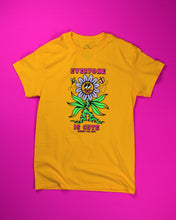 Load image into Gallery viewer, Gold short sleeve t-shirt that reads Everyone is Cute (except for you) in pink font. The (except for you) is in a very small font. In the center is a large flower with a thorny green stalk and 6 flailing leaves. The flower petals are blue, pink and white confetti and the yellow center of the flower has googly eyes round cheeks and a pink double tongue sticking out. On either side of the top of the flower is a flying bee and butterfly.
