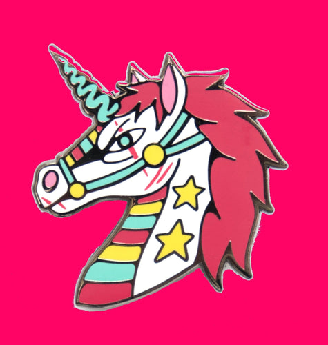 Unicorn enamel pin with hot pink mane, rainbow and stars designed by Crocodile Jackson.