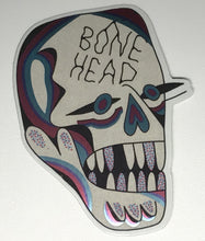 Load image into Gallery viewer, Holographic sticker design from Crocodile Jackson of a skull that reads Bone Head.