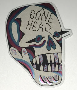 Holographic sticker design from Crocodile Jackson of a skull that reads Bone Head.