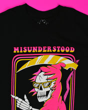 Cargar imagen en el visor de la galería, A black short sleeve t-shirt that reads Misunderstood above the graphic and But Still Lookin' Good below the graphic in pink to gold font. The graphic in the center is a skull in a pink cloak sporting sunglasses with a gold frame. His left hand is sticking out of the cloak making a fist and his index finger and thumb are sticking out. Behind him he is holding a sickle that has a pink shaft and gold blade.
