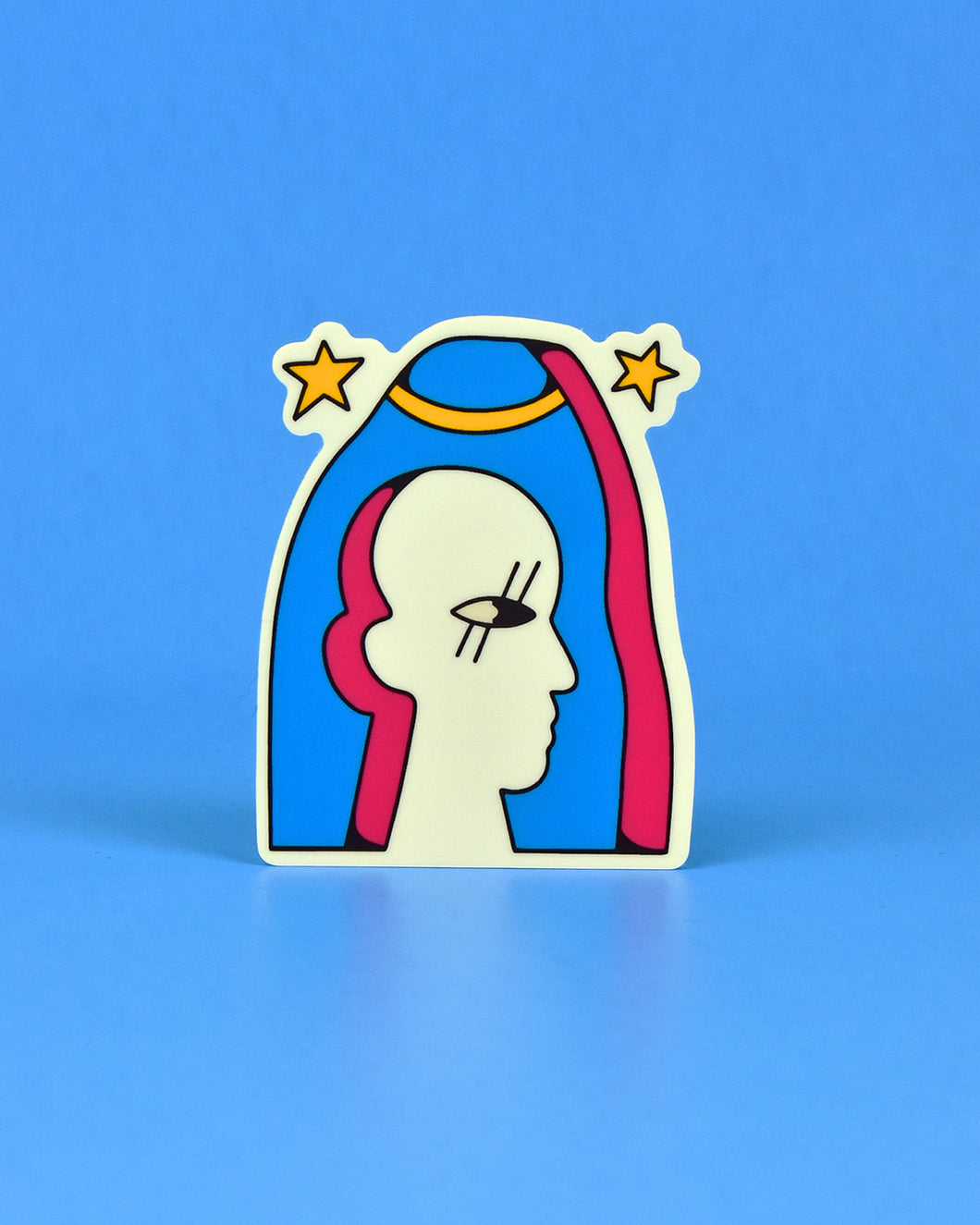 With a stone cold expression to die for, this Crocodile Jackson sticker will win you over with it's beauty and simplicity. Vinyl sticker of a blue slab with the silhouette of a person cut out of it, revealing pink edges. A single eye is shown with parallel and straight eyelashes. Slab features a golden band and 2 yellow stars.