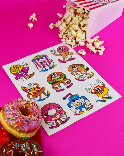 8x10 sheet of 9 animated snack stickers with a face, arms and legs with shoes. Top row of 3 are fries, popcorn and ice cream cone. The 2nd row is a pizza slice, a burger and a taco. The last row is a doughnut, a soda and a candy corn.