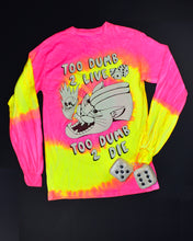 Load image into Gallery viewer, The back of a bright pink & yellow swirling tie dye long sleeve t-shirt. Black and white print that reads Too Dumb 2 Live at the top and Too Dumb 2 Die at the bottom. The center has a snarling bob cat head with a flame coming out of it's mouth. A skull is in the flame. 2 dice are above the bob cat.