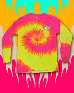 The front of a bright pink & yellow swirling tie dye long sleeve t-shirt. Two black & white dice are on the left pocket area of the shirt. The background are green, orange, purple and black flames.