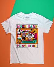 画像をギャラリービューアに読み込む, A white short sleeve t-shirt with Work Hard printed at the top of the graphic in the center of the front of the shirt. Play Nice is printed at the bottom. Each letter is a different color of either pink, mint green, hot pink or yellow. The center graphic is a cartoon of a spotted dog with a very long snout, a lava lamp, Cloudia and person with very long legs. All in the same colors as the letters.