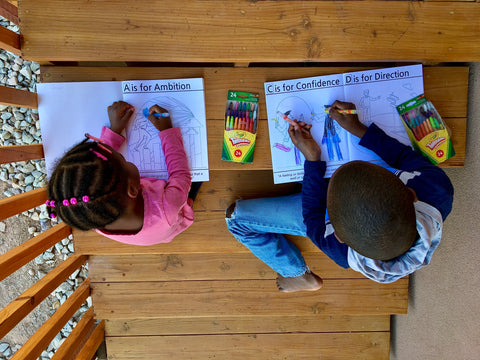 children learning while coloring