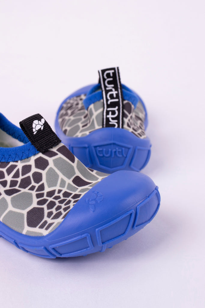 aqua shoes in blue with turtle shell print