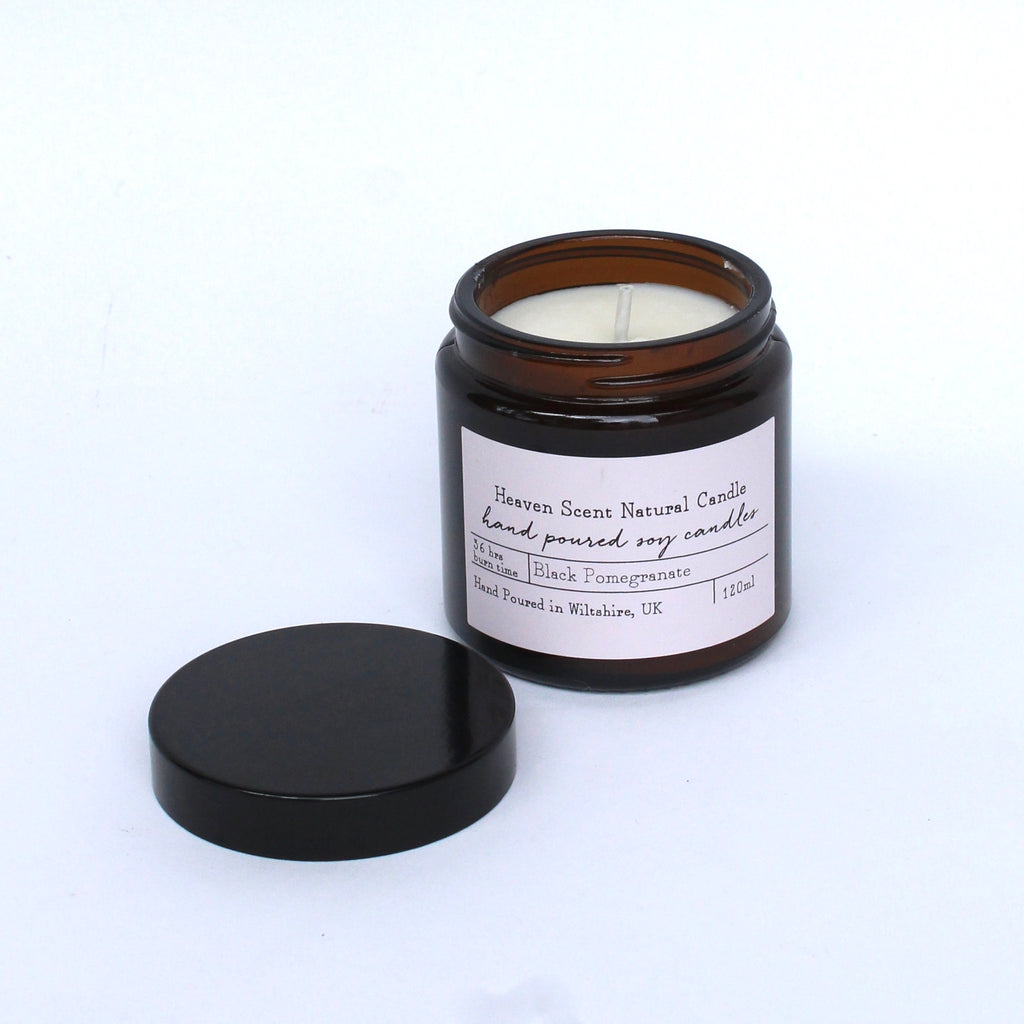 Black pomegranate scented candle brown glass jar