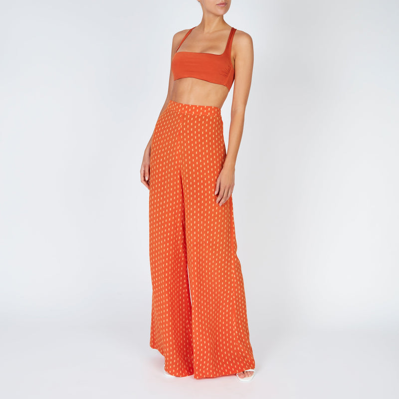 EVARAE Neema Cross Back Square Neck Bikini Top in Ice Tea Orange Resort20 Front Worn with Diana Silk Trousers Model