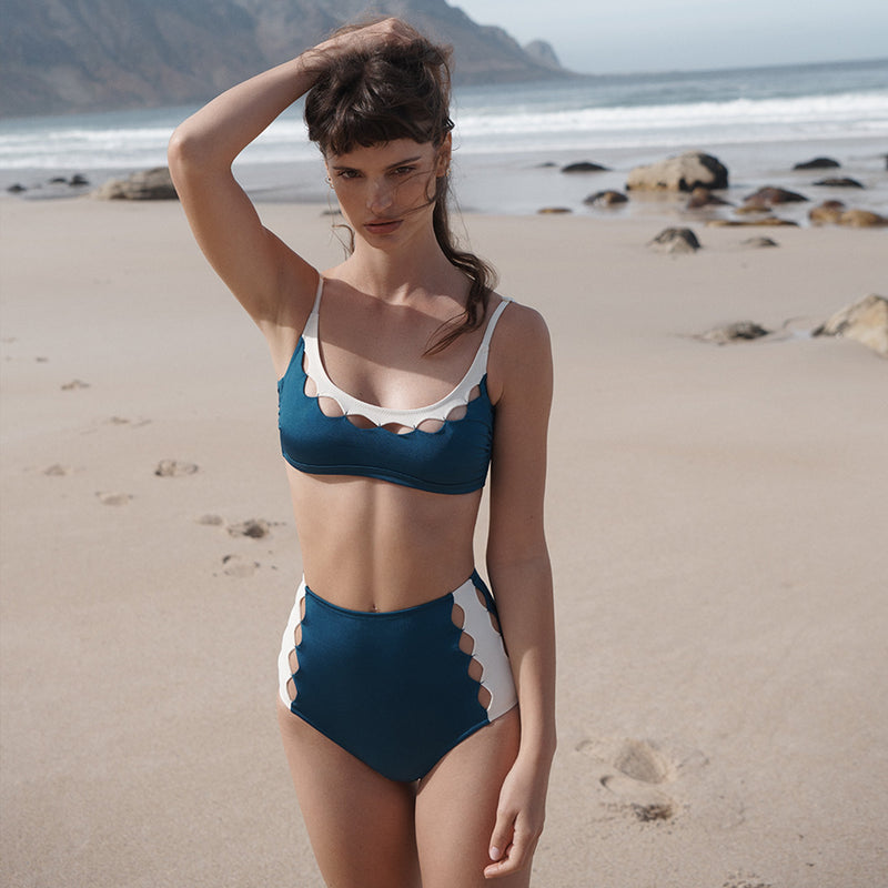 EVARAE Rei Bikini Top Cut Out Detail Silky Sustainable Fabric in Blu Tropico resort 20 front model beach