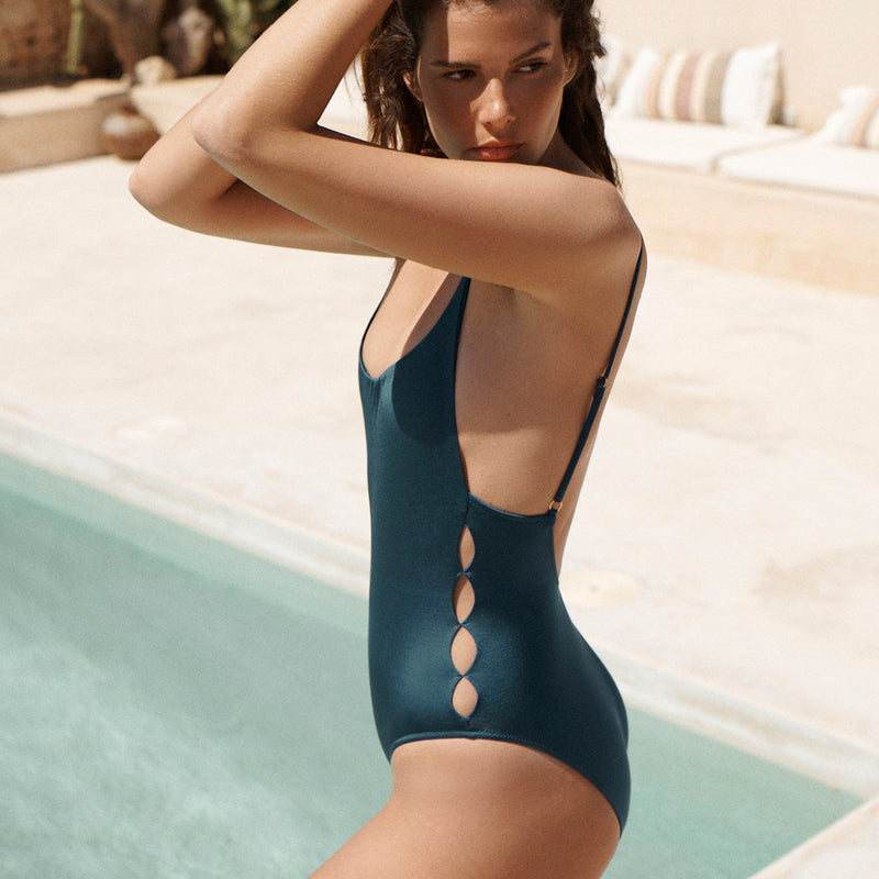 EVARAE Yoli Swimsuit Flattering Shape. Side cut out detail and open low back in Blu Tropico. Sustainable swimwear. Resort 20. Side Detail