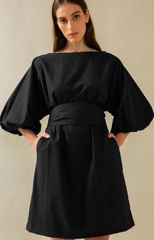 TAUKO Design is a Helsinki-based ecological women's clothing brand. The picture shows a classic dress in black.