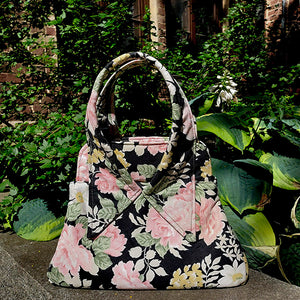 Floral handbag made of recycled fabric from the 1990s. Bohemian Insanity.