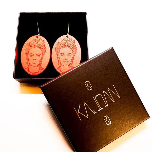 Frida Kahlo earrings, neon orange. Made of birch plywood.