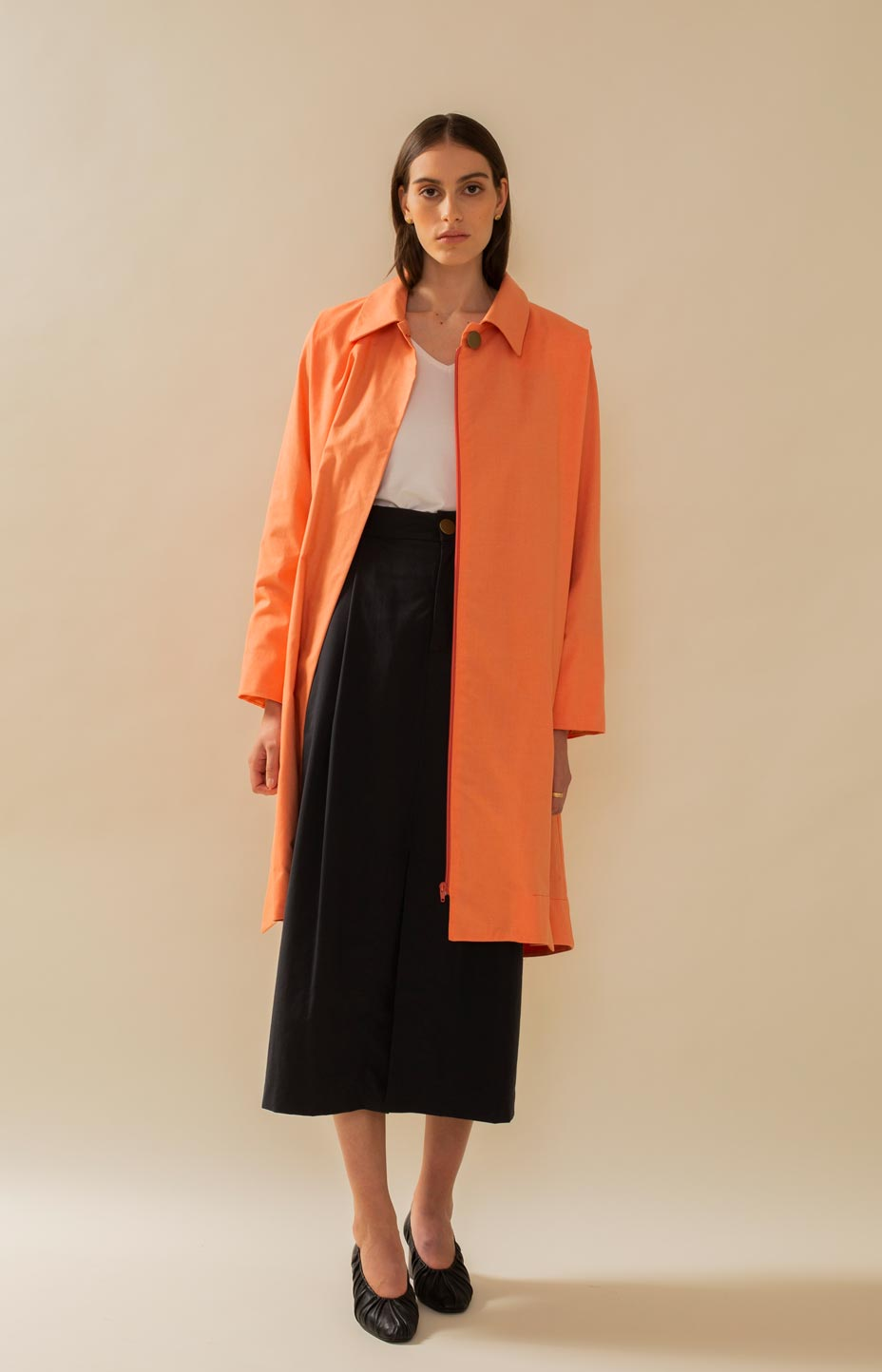 Minimalistic trench coat in fresh cantaloupe color.
