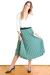 CHAIN REACTION PLEAT SKIRT IN GREEN