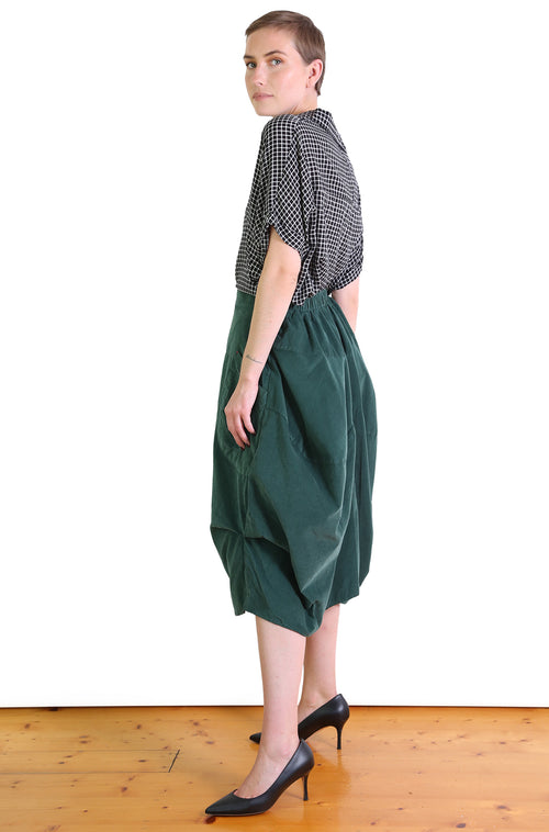DOWNTOWN CORD MILWAUKEE SKIRT IN BOTTLE GREEN