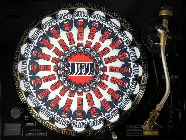 "SHTEVIL Combi Package: - Vinyl record ""Stung""+Turntable Slipmat+Button"