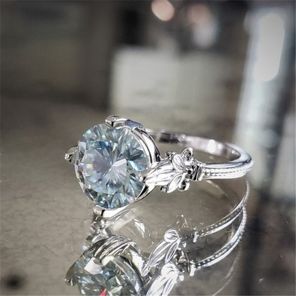 Round Cut Solitaire Sky Blue Flower Ring