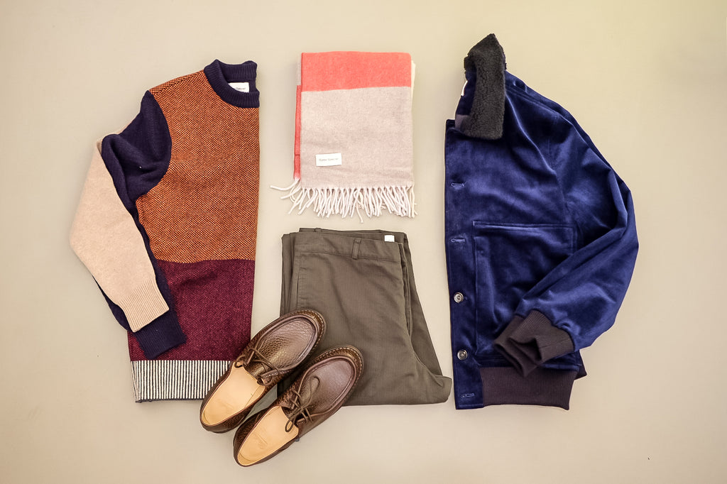 A flat lay of articles of clothing showing how to effectively colour block, all by Oliver Spencer.