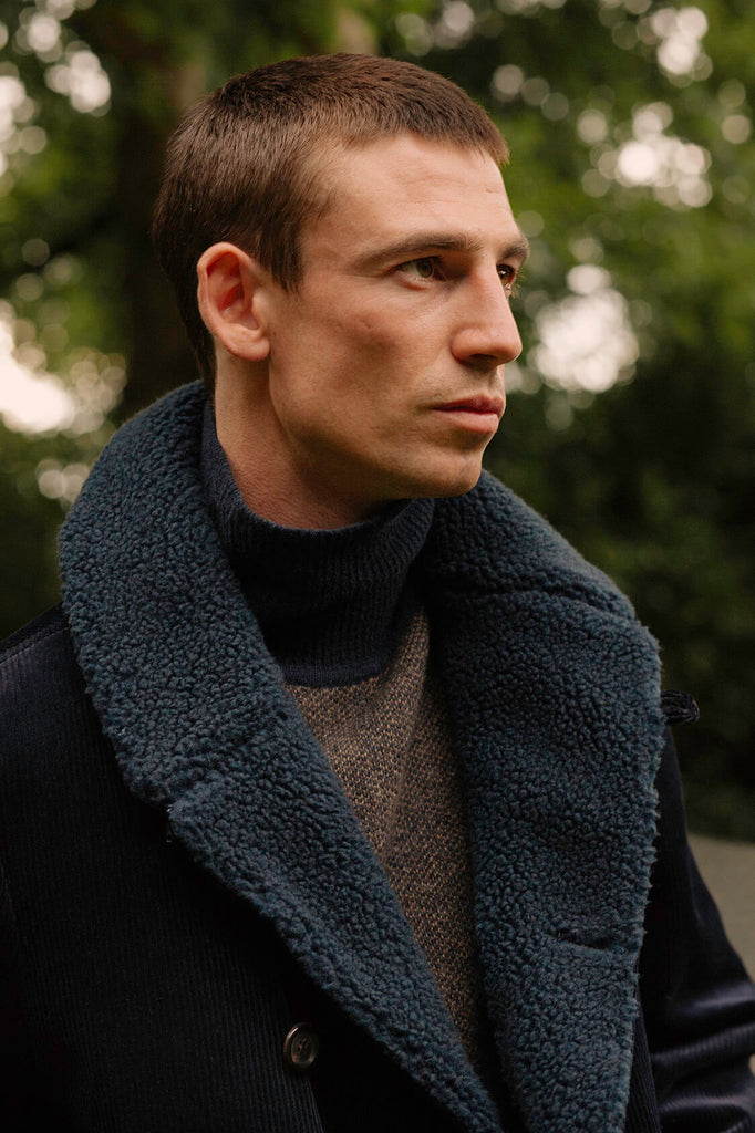A model wearing the navy Newington coat by Oliver Spencer.