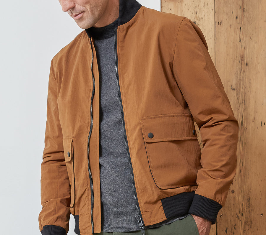 Oliver Spencer's Bermondsey bomber jacket in a vibrant ochre colour.