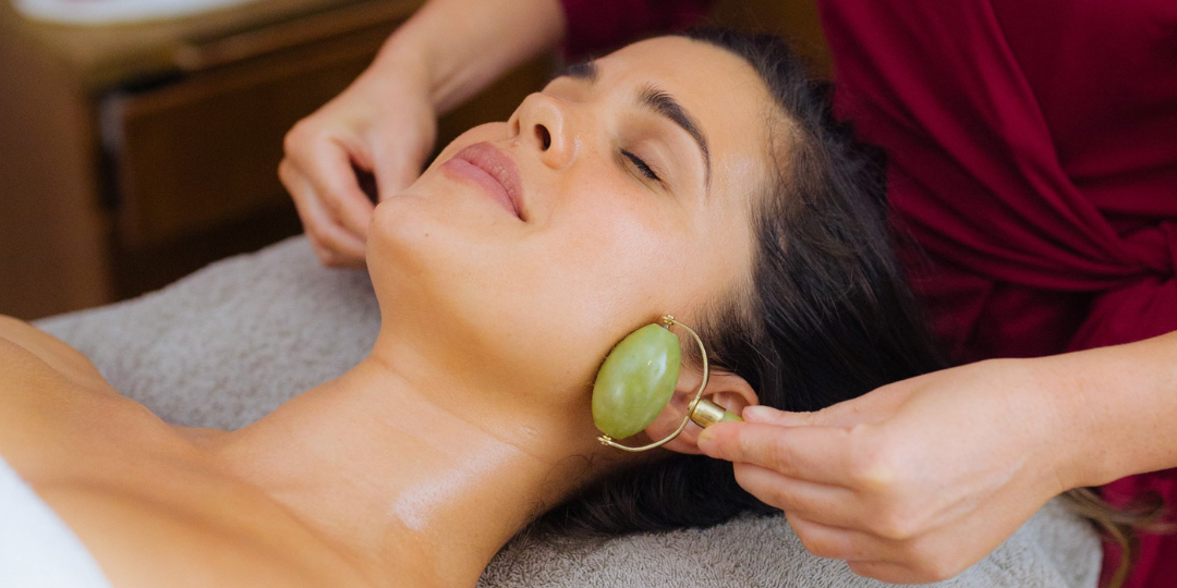Woman laying on towel receiving a spa facial