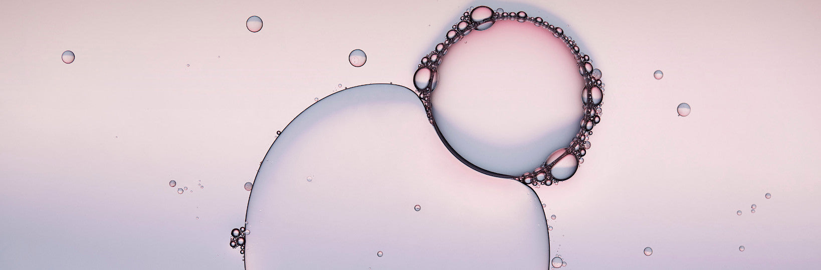 Big and small bubbles on light purple background