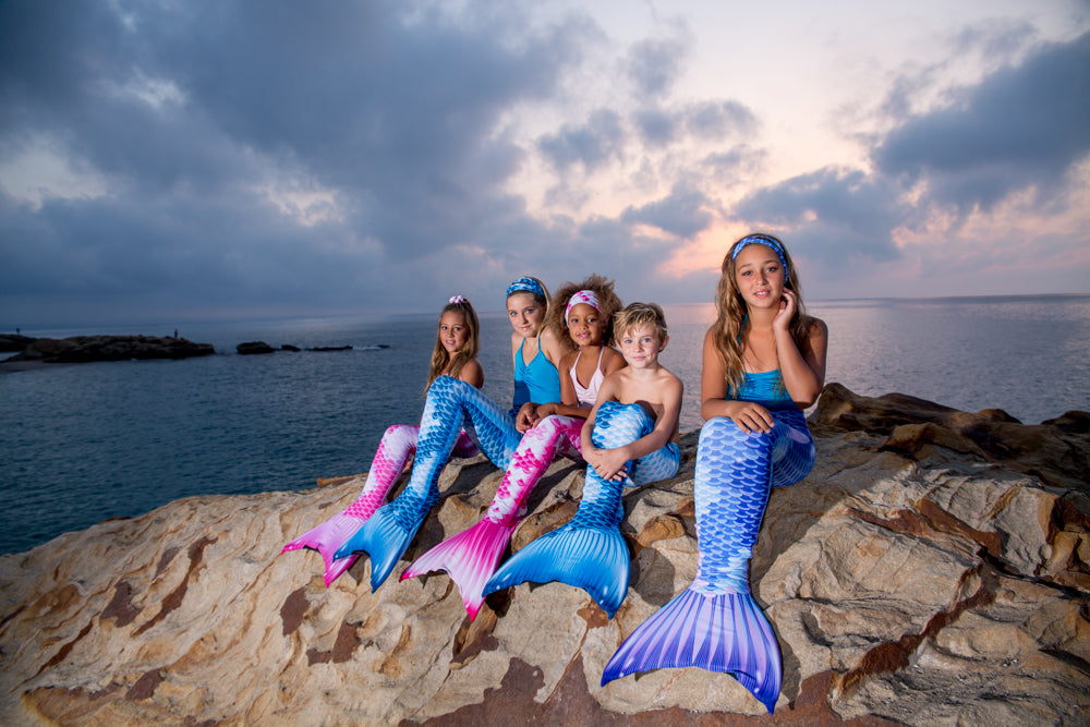 Real mermaids and merboy at the beach