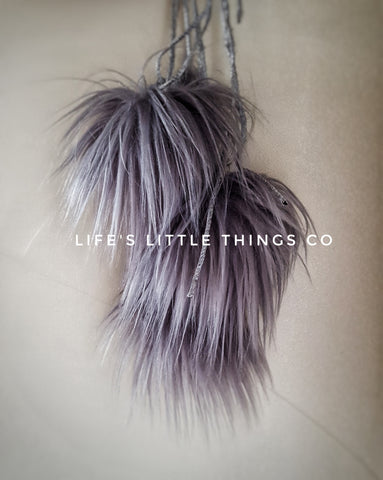 "Stormy Pom *Grey in color with a purple undertone *Long length fur (approximately 2.5"") *Very wispy and not as full"