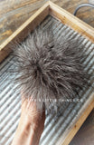 "Black Wolf Pom Dark grey in color with strands of black and white throughout *Medium length fur (approximately 1.5"" with some strands reaching 2"") *Full look"