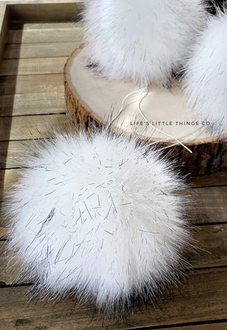 "Polar Bear Pom *White in color with specks of black at the tips *Medium length fur (approximately 1.5"") *Full look and soft feel"