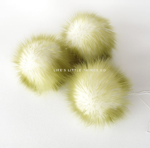 "Kiwi Pom *White center and olive green tips *Medium length fur (approximately 2"") *Full and soft feel"