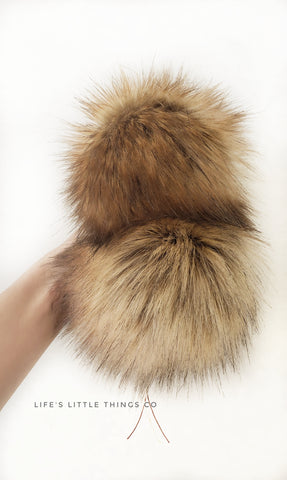 "Toffee Pom *Brown, beige, tan variations throughout with single black furs *EVERY POM is UNIQUE *Long length fur (approximately 2-2.5"") *Full look and soft feel"