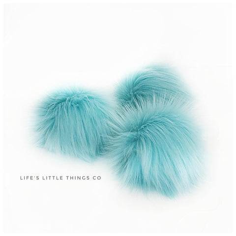 "Cotton Candy Pom *Soft aqua color throughout *Medium length fur (approximately 2"") *Full look"
