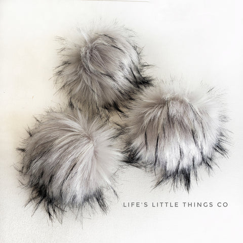 "Platinum Pom *Grey/silver in color with light grey tufts with black tips. *Medium length fur (approximately 2"" - 3"") *Luxurious and amazingly soft feel"