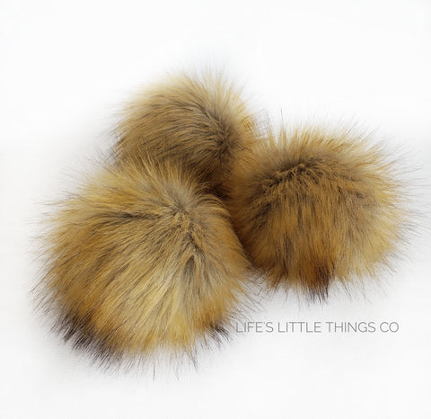 "Honey Pom *Tan center changing to a honey colored ends with brown tips throughout *Medium length fur (approximately 2.5"") *Full look and soft feel"