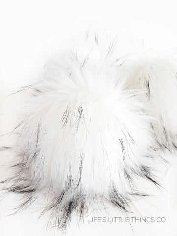 "Snowy Owl Pom *White color with spots of cream and black tips *Long length fur (approximately 2-3"") *Full look and soft feel"