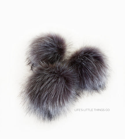 "Graphite Pom *Dark grey center to light grey ends. Hairs of white throughout *Long length fur (approximately 2.5"") *Very full pom *Luxurious and amazingly soft feel"