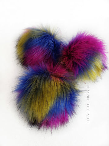 "Mardi Gras Pom *Patches of blue, pink and yellow throughout.  EACH POM is UNIQUE! *Long length fur (approximately 2.5"") *Very full pom *Luxurious and amazingly soft feel"